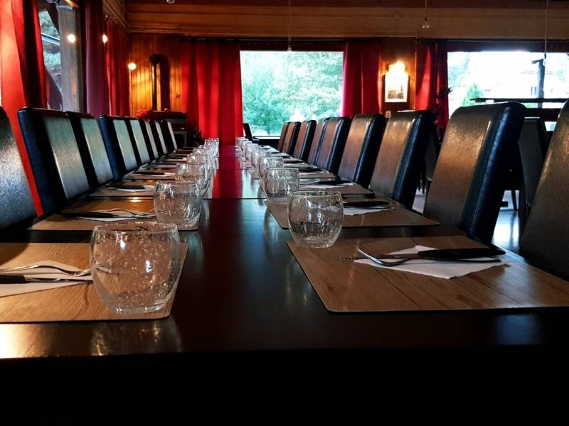 a large table set in the restaurant